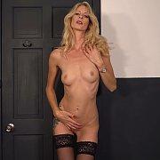 Slender Blonde Babe In Stockings Strips Naked