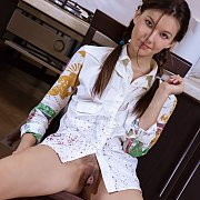 Pigtails Teen Strips Naked