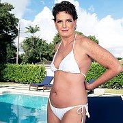 Mature Lady Strips Off Bikini By The Pool