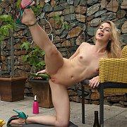 Flexible Girl Masturbates On Patio