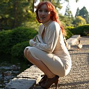 Pale Flesh Red Haired Gal Flashing Outside