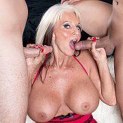 Mature Woman With Two Men