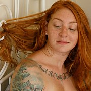 Freckled Face Redhead With Tattoos