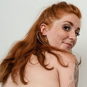 Naked Freckled Face Redhead Showing Her Ass