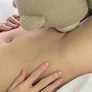 Asian Beauty Plays With A Teddy Bear