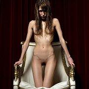 Pretty Skinny Model Posing Nude In A Chair