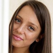 Alluring Freckled Brunette Babe With A Smirk