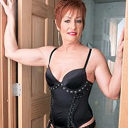 Mature Redhead Ruby Strips Lingerie