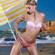 Pigtails Beauty Strips Bikini At The Beach