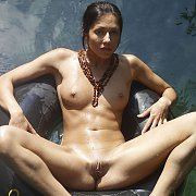 Tanned Nude Babe Floating On An Inner Tube