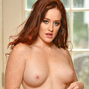 Freckled Chest And Arms Redhead Topless In Yoga Pants