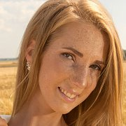 Lovely Freckles Redhead Erotica Model In A Field