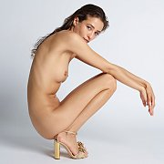Nude Fantasy Squats Down In Heels During Shoot