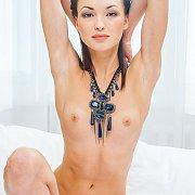 Skinny Nude Brunette Model Posing In A Big Necklace
