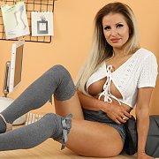 Stockings And Skirt Teasing Babe