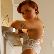 Short Red Hair With Freckles In Lingerie
