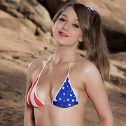 American Flag Bikini On A Brunette Babe Posing Outdoors