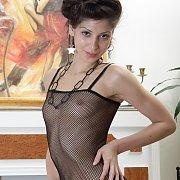 Slim Girl In Fishnet Bodystocking
