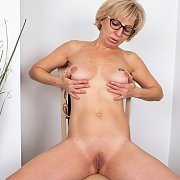 Mature Russian Strips And Rubs Shaven Twat