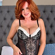 Sexy Mature Redhead In Her Teddy Lingerie On The Bed