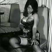Lingerie And Stockings Teasing Woman In Vintage Photo