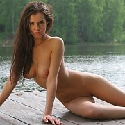 Hot Model On A Lake Dock