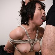 Rope Tied Asian Gets Mouth Fucked