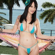 Great Looking Milf Strips Tiny Bikini