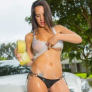 Busty Gal Strips While Washing Car