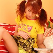 Pigtails redhead in yellow plaid skirt