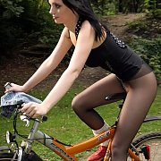 Cute European Lady In Panyhose Riding Bicycle