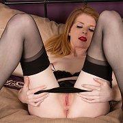 Legs Spreading Creamy Redhead Milf
