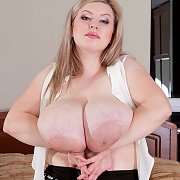 Holding Up Her Huge Plump Tatas
