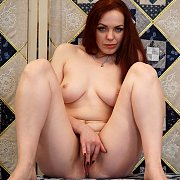 Redhaired Milf Strips And Rubs