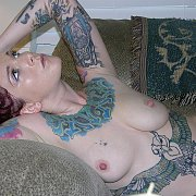 Amateur chick with tattoos gets naked