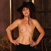 Lusty Topless Mature Lady With Small Breasts