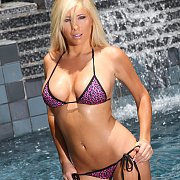 Busty Blonde Bikini Babe Poolside