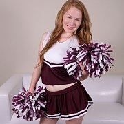 Redheaded Cheerleader Teasing At Home