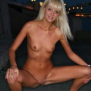 Tanned slim blonde at night