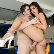 Cute Schoolgirl From Japan Sitting On A Desk