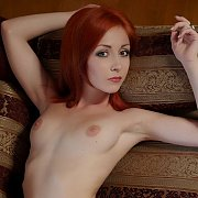 Lusty Red Hair Model With Shaved Pussy