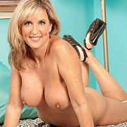 Sexy blonde milf strips