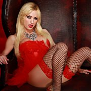 Angela Sommers Red Leather Chair