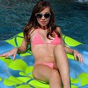 Capri Anderson Strips Bikini