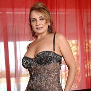 Cuddly Mature Mom Strips Lingerie