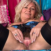 Hot Mature In Lingerie And Stockings Spreads Bush