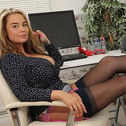 Black And White Pic Of A Stockings Gal With Furry Muff