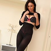 Lusty Nylons Babe Stripping In Bedroom