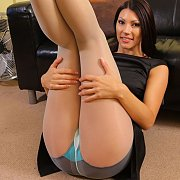 Beautiful Woman Holding Up Her Nylon Legs