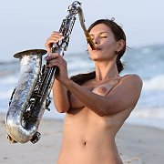 Nude Beach Babe Playing The Sax